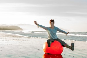 Lisa Vincenti balance ball at beach